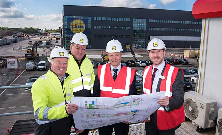 L-R Gordon Rafferty, Head of Property at Lidl Scotland; Ross Millar, Regional Director at Lidl Scotland; Graham Simpson, MSP for Central Scotland; and Neil Gray, MP for Airdrie and Shotts