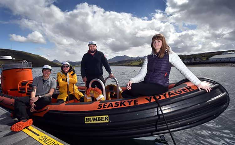 Seaskye's 11-metre vessel (pictured) will be upgraded to a 13- metre vessel, with HIE support. L-R: Jordan Young, Mark Coombe and Kenny MacKinnon of Seaskye Marine, with Eilidh Ross of HIE. Credit Iain Smith/HIE