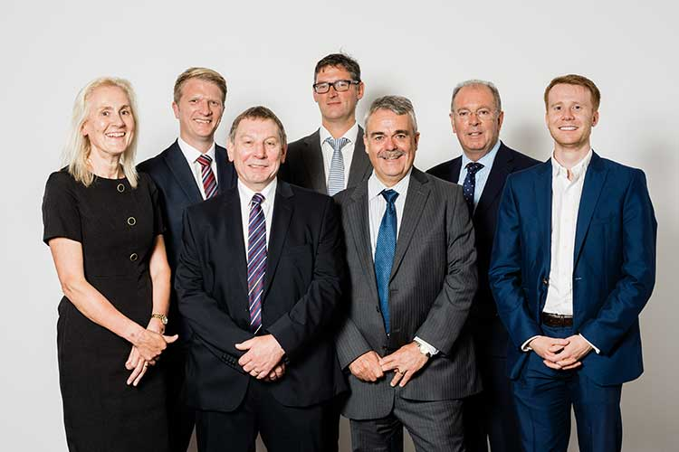 L-R – Partners Kathleen Kirkland, Angus Cowie, George Flett, Graeme Reid, Ken Tait, Ian Williams and David Booth