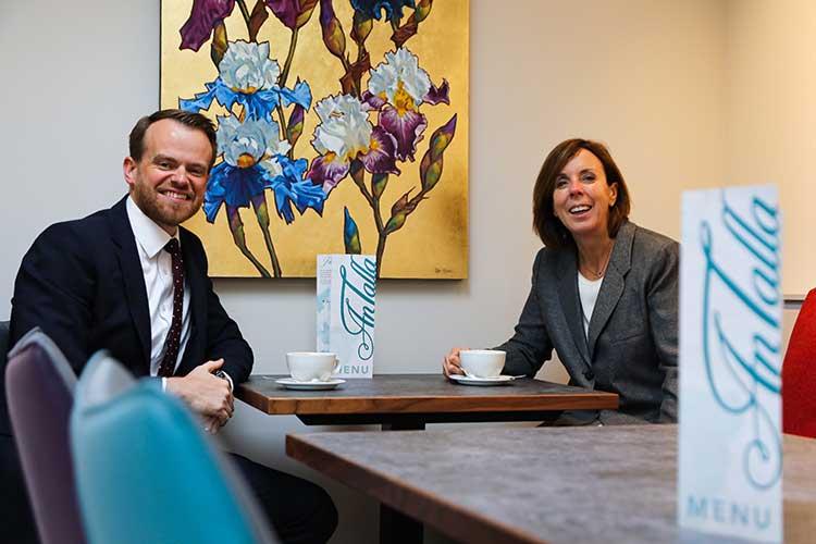 Barrie Aird and Freda Newton enjoy coffee in An Talla